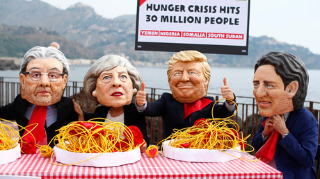 Activists 'eat spaghetti' while imitating G7 leaders to highlight famine crisis