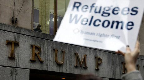 Protesters gather outside the Trump Building against America's refugee ban, U.S., March 28, 2017. © Lucas Jackson