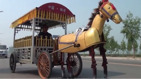 Chinese farmer builds iron horse to pull him around town