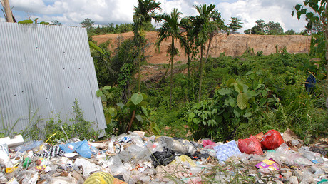 Garbage and destroyed hill in Kalimantan, Indonesia © Andre Vltchek