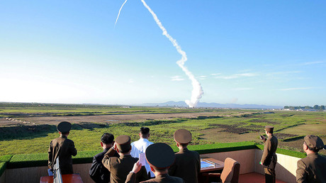 North Korean leader Kim Jong Un watches the test of a new-type anti-aircraft guided weapon system © Reuters