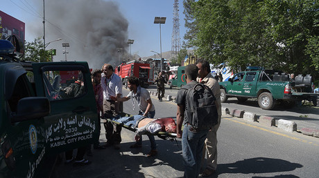 A victim is carried away on a stretcher at the site of a car bomb attack in Kabul on May 31, 2017. © Shah Marai