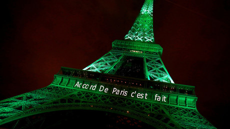 FILE PHOTO: The Eiffel tower is illuminated in green with the words
