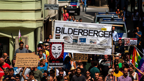 FILE PHOTO: Protesters take part in a demonstration against the Bilderberg conference in Telfs, Austria. © Christian