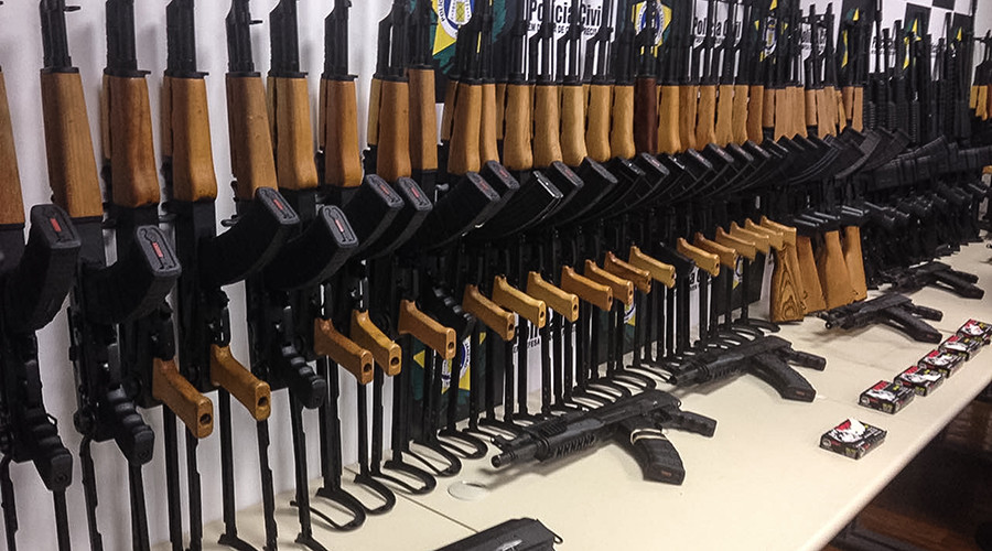 Fighter jet: 60 assault rifles found hidden onboard Miami-Rio flight