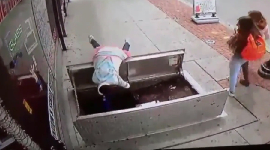 Woman distracted by phone tumbles through sidewalk trapdoor in horror fall (VIDEO)