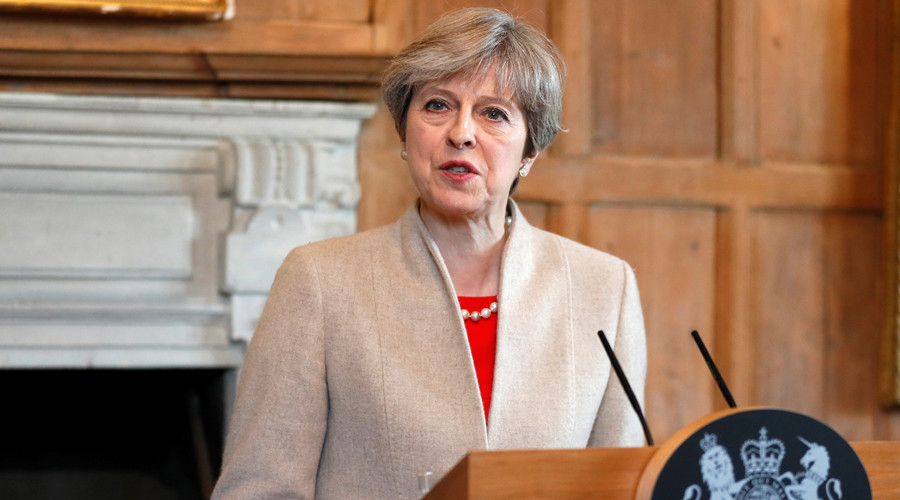 Theresa May faces grilling by her own party as she cobbles together minority govt