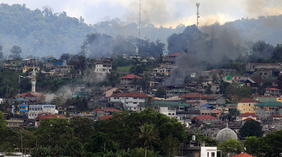 'At least 100 bodies' on streets of ISIS-occupied city, says Philippine official