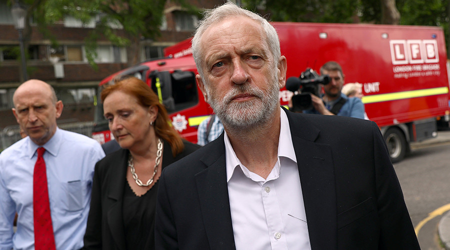 May & Corbyn visit site of London tower fire, but PM avoids talking to survivors