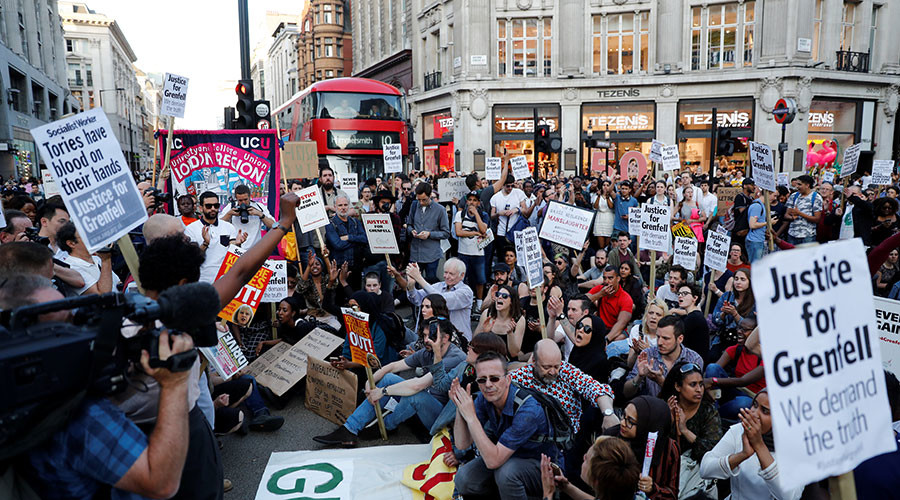 Ruptly producer attacked & violently kicked at Grenfell fire protest in London