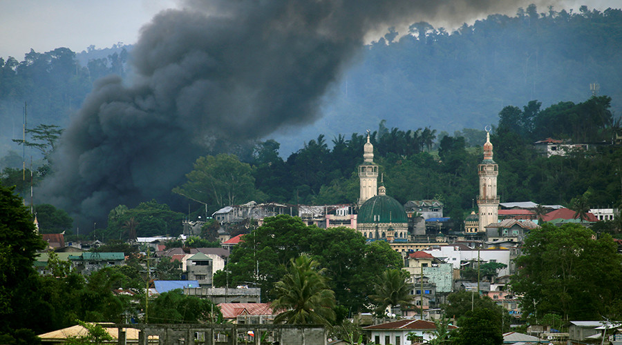 Pro-ISIS rebels storm school in Philippines, students held hostage