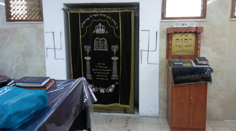 Jerusalem synagogue vandalized with swastikas, holy books burned
