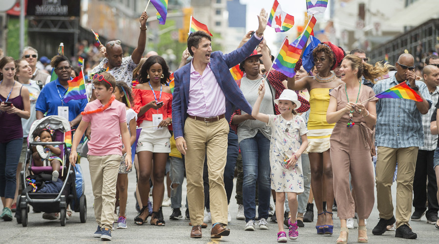 Trudeau celebrates 'multiple layers of identities' with Pride Mubarak socks (PHOTOS)