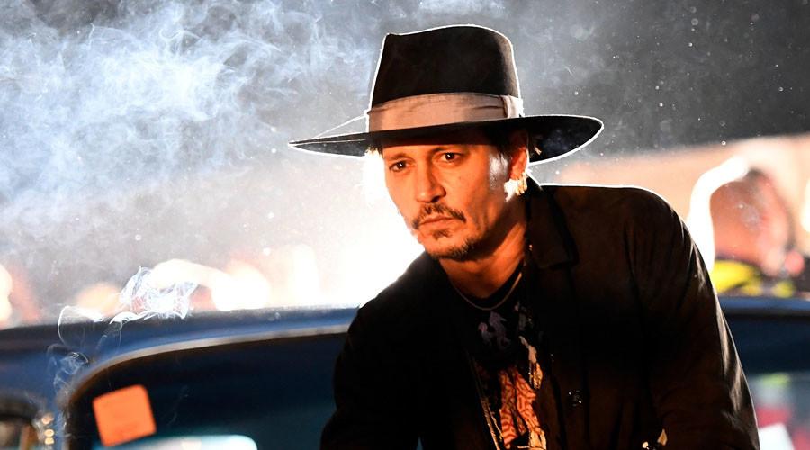 Johnny Depp plays the fool, jokes about Trump assassination