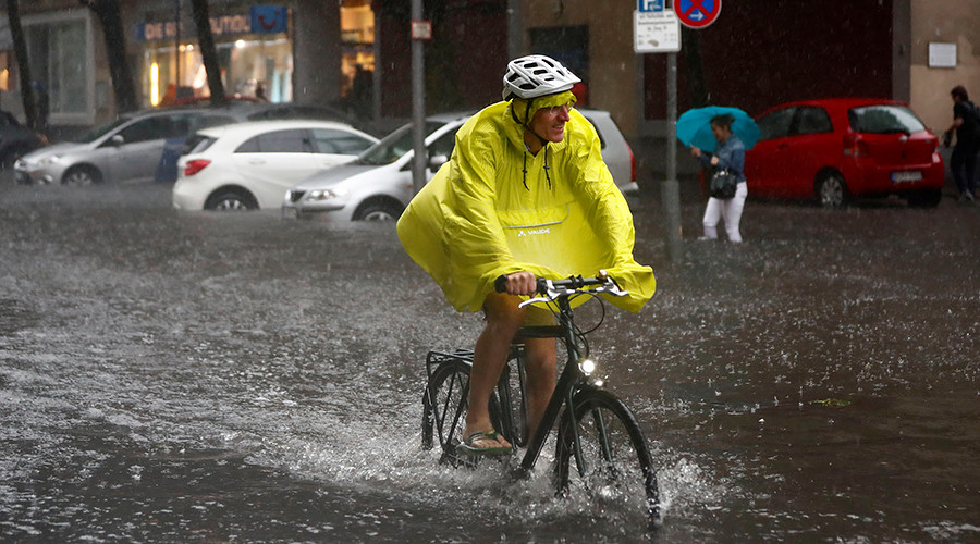 Monster storm batters Berlin: Cyclists persevere, surfers thrive (VIDEOS PHOTOS)