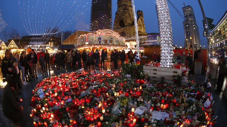 FILE PHOTO Flowers and candles are placed near the Christmas market in Berlin, Germany, December 22, 2016© Fabrizio Bensch