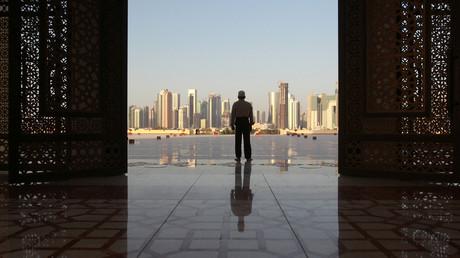 A man stands at Imam Muhammad ibn Abd al-Wahhab Mosque in Doha, Qatar. © Naseem Zeitoon
