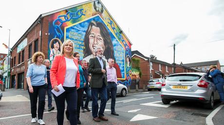 Sinn Fein leader Michelle O'Neill and party president Gerry Adams walk outside the Sinn Fein offices in Belfast, Northern Ireland, June 9, 2017. © Liam McBurney