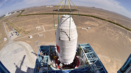 The Hard X-ray Modulation Telescope (HXMT), being lifted onto a Long March-4B rocket at the Jiuquan Satellite Launch Center, China June 15, 2017. © AFP