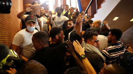 Demonstrators crowd onto a staircase as they enter Kensington Town Hall, during a protest following the fire that destroyed The Grenfell Tower block,  June 16, 2017. © Stefan Wermuth