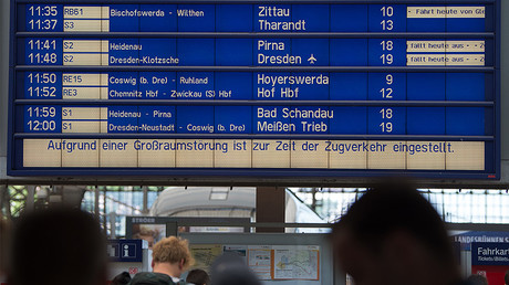 A departure board at the main train station in Dresden, eastern Germany, shows delays in traffic on June 19, 2017. © Arno Burgi