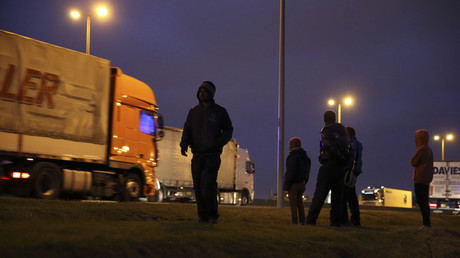 FILE PHOTO: Migrants stand near a road, Calais. © Pascal Rossignol