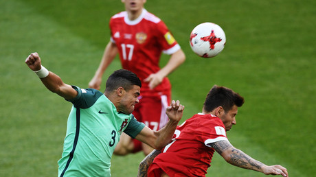 Pepe (Portugal) and Fyodor Smolov (Russia) during the 2017 FIFA Confederations Cup match between Russia and Portugal. © Grigoriy Sisoev