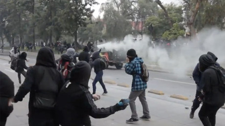 Police use tear gas in clashes with protesters in Chilean capital