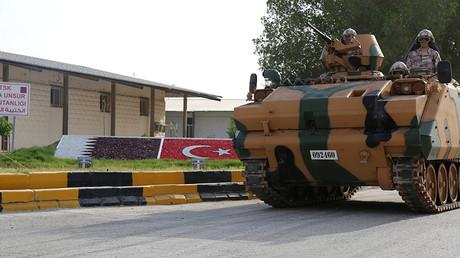 Turkish APC drives at their military base in Doha, Qatar June 18, 2017 © Reuters