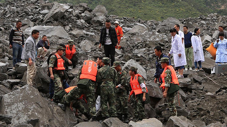 100+ feared buried in landslide in China