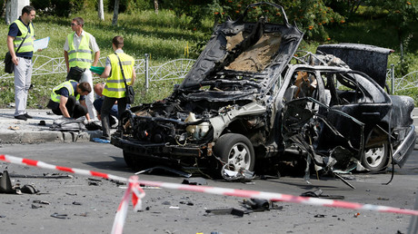Investigators work at the scene of a car bomb explosion which killed Maxim Shapoval, a high-ranking official involved in military intelligence, in Kiev, Ukraine, June 27, 2017 © Valentyn Ogirenko