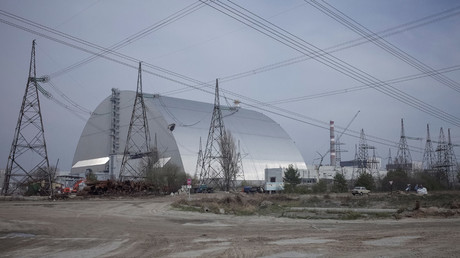 A general view shows a New Safe Confinement (NSC) structure over the old sarcophagus covering the damaged fourth reactor at the Chernobyl nuclear power plant © Gleb Garanich