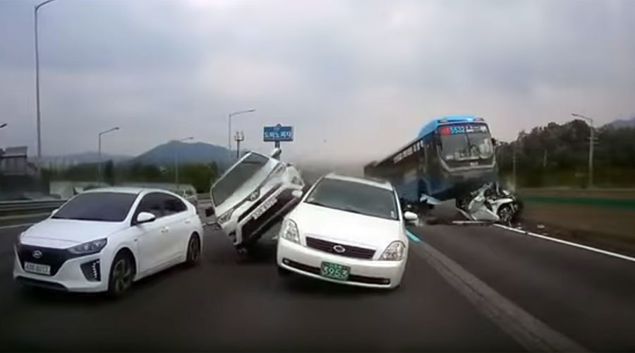 Out-of-control bus crushes car in horrific motorway pile-up (VIDEO)