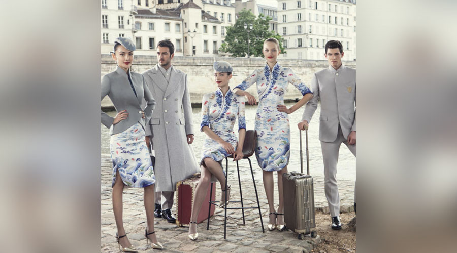 Mile-high fashion: Chinese airline staff don haute couture uniforms (PHOTOS)