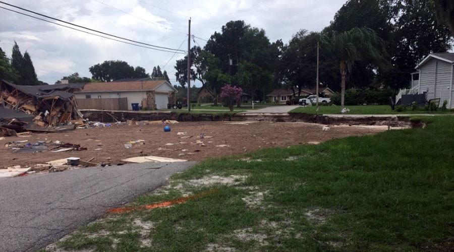Enormous sinkhole devours two homes, threatens Florida neighborhood