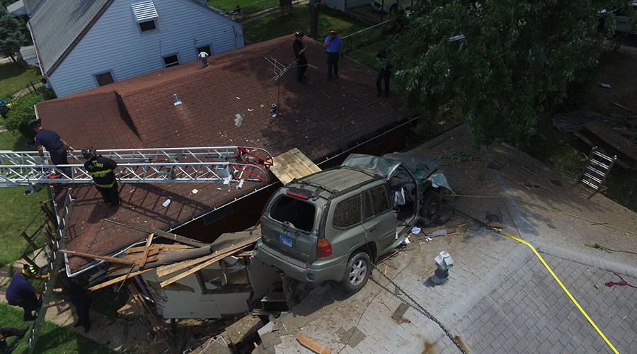 Homeowner cheats death as SUV crashes into his roof (VIDEOS, PHOTOS)