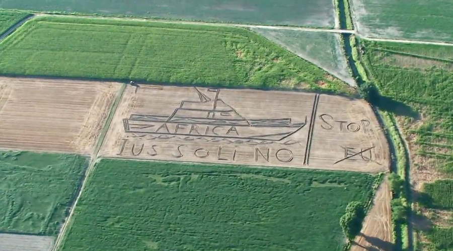 'Stop, EU': Giant anti-migrant message ploughed into Italian field (VIDEO)