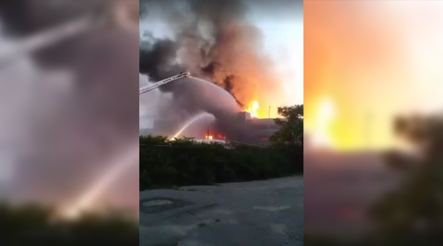 Eight-alarm fire in Waltham engulfs five buildings in new complex