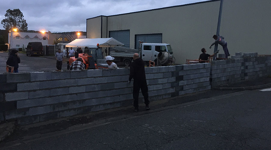 French protesters build wall around former hotel set to become migrant shelter