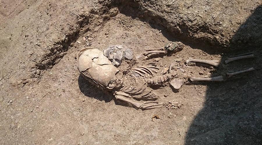 'Alien' toddler skeleton with deformed skull unearthed in Crimea (PHOTOS)