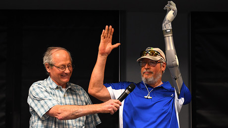 US Army veteran Fred Downs smiles as US Army Veteran Artie McAuley(R) is shown with his LUKE prosthetic arm, New York June 30, 2017. © Timothy A. Clary / AFP