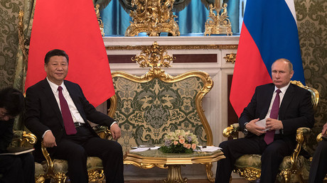 July 4, 2017. From right: Russian President Vladimir Putin meets with People's Republic of China President Xi Jinping in Moscow. © Sergey Guneev