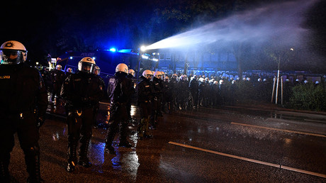 German riot police use a water cannon during a protest ahead the G20 summit in Hamburg, Germany, July 4, 2017 © Fabian Bimmer