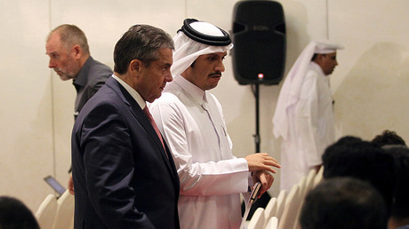 Qatar's Foreign Minister Sheikh Mohammed bin Abdulrahman al-Thani walks with German Foreign Minister Sigmar Gabriel following a joint news conference in Doha, July 4, 2017 © Naseem Zeitoon