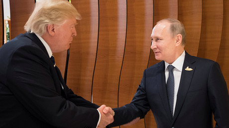 Russia's President Vladimir Putin and U.S. President Donald Trump shake hands during the G20 Summit in Hamburg, Germany in this still image taken from video, July 7, 2017. © Steffen Kugler / Bundesregierung
