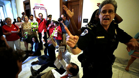 Healthcare activists protest to stop the Republican health care bill at Russell Senate Office Building on Capitol Hill, July 10, 2017 © Yuri Gripas