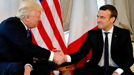 FILE PHOTO: US President Donald Trump (L) shakes hands with French President Emmanuel Macron © Peter Dejong