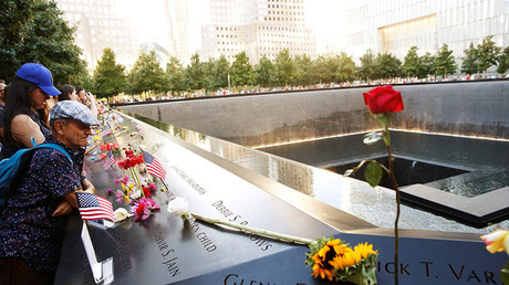 Visitors look out over the National September 11 Memorial and Museum on the 15th anniversary of the 9/11 attacks in Manhattan, New York, US, September 11, 2016. © Lucas Jackson