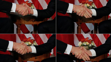 US President Donald Trump and French President Emmanuel Macron amid one of their fierce handshakes © Jonathan Ernst