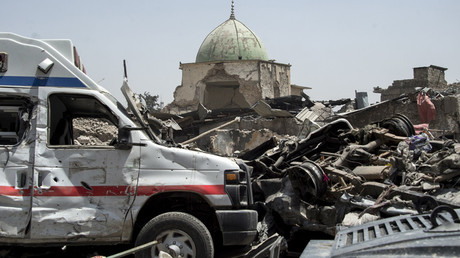 A general view of destroyed vehicles in the vicinity of Al-Nuri Mosque in the Old City of Mosul © Fadel Senna
